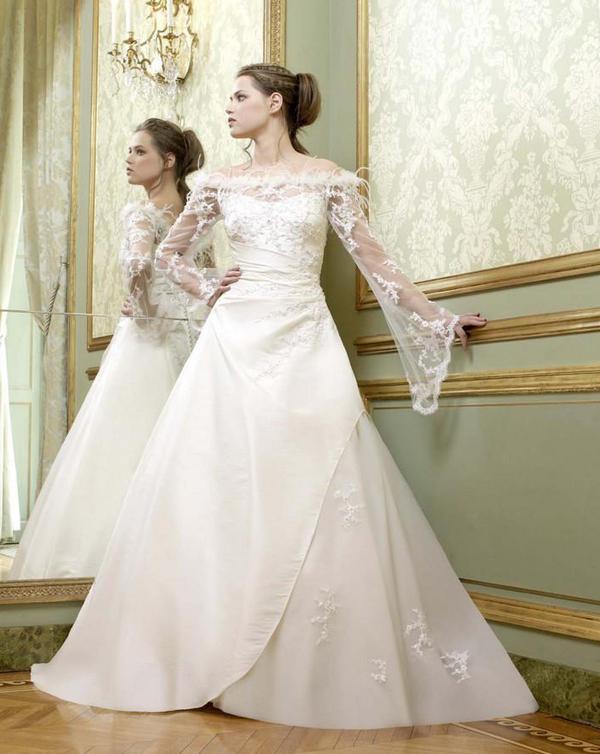Женское свадебное платье с вуальными рукавами фото.